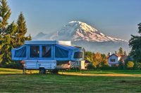 pop up tent camper in the shadow of a mountain